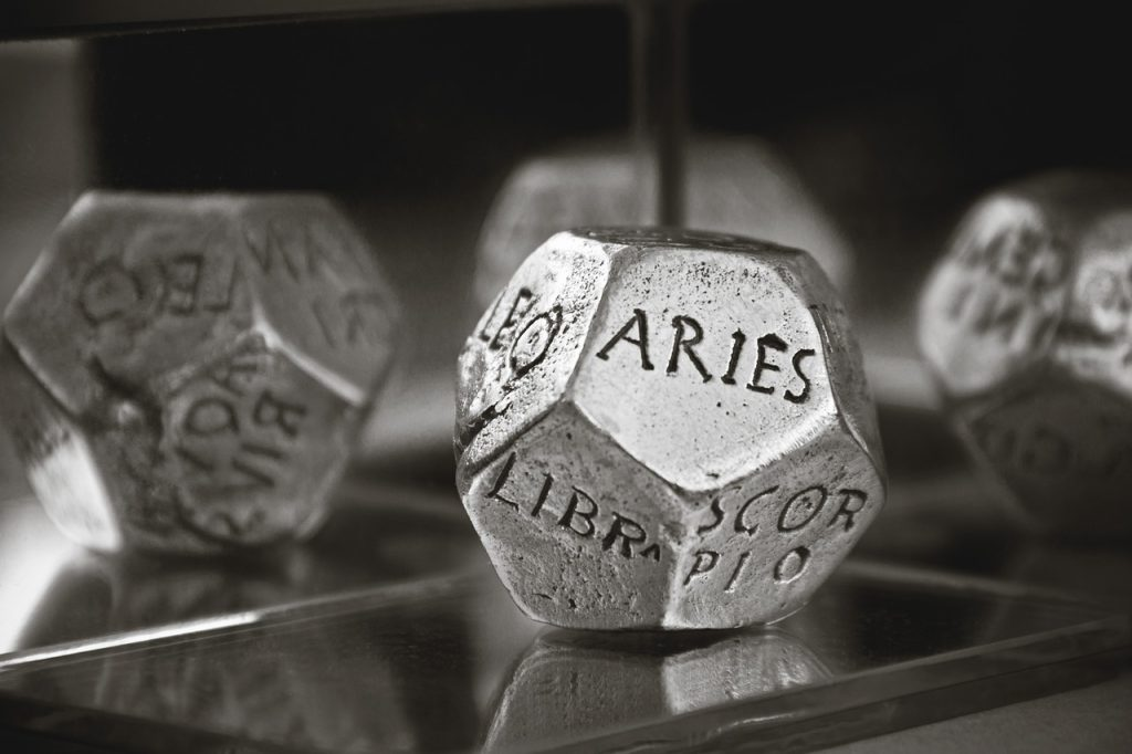astrology dice with aries showing
