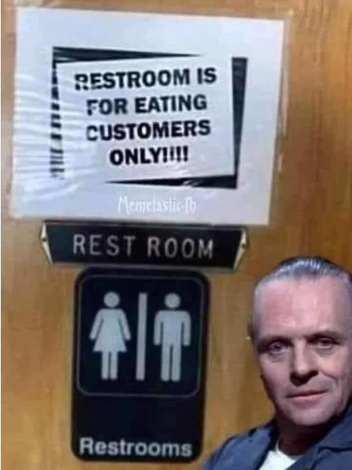 A sign on a restroom door with Hannibal Lector standing in front of it. Sign reads: Restroom is for eating customers only!!!!